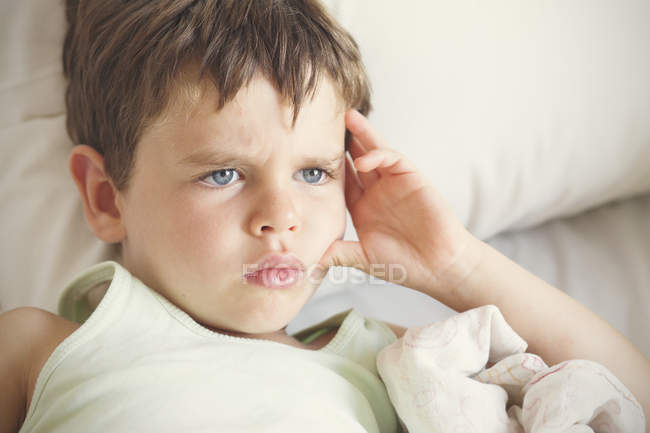Boy looking away with facial expression — Stock Photo
