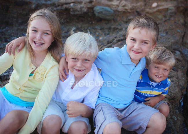 Group of children sitting in row — Stock Photo