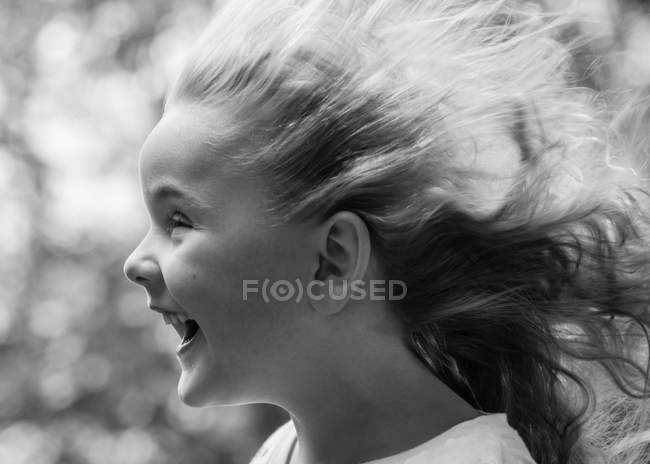 Girl with blown hair — Stock Photo