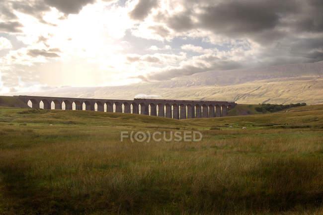 Steam train crossing Yorkshire Moors — Stock Photo