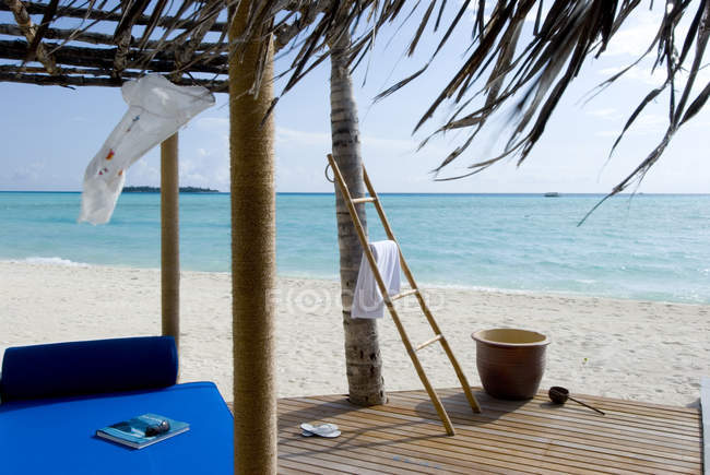 Wooden sun-deck on beach — Stock Photo