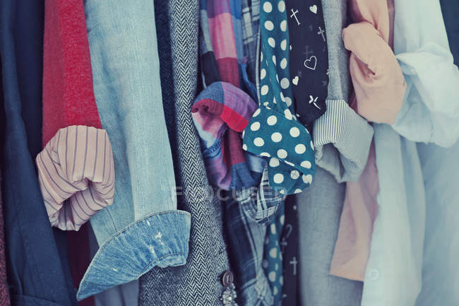 Shirts hanging in a row — Stock Photo