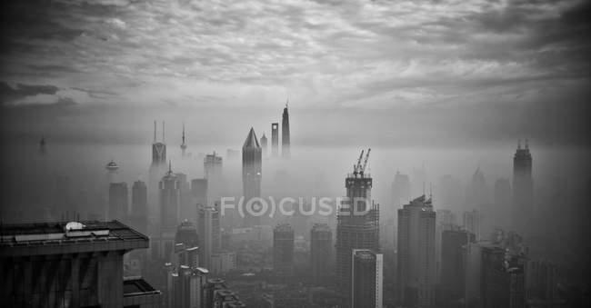 Shanghai cityscape in fog — Stock Photo