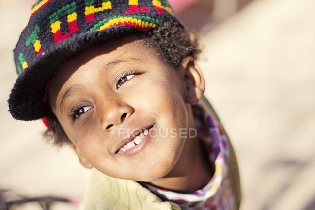 Young girl wearing colorful hat — Stock Photo