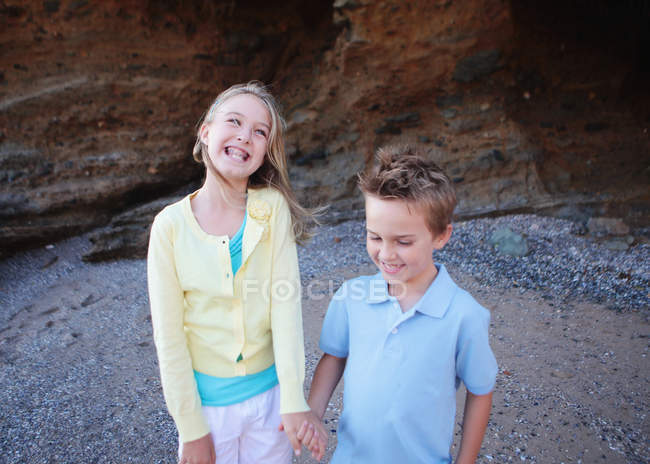 Brother and sister holding hands — Stock Photo