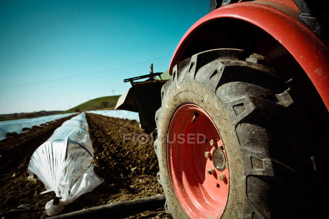 Tractor on cultivated ground — Stock Photo