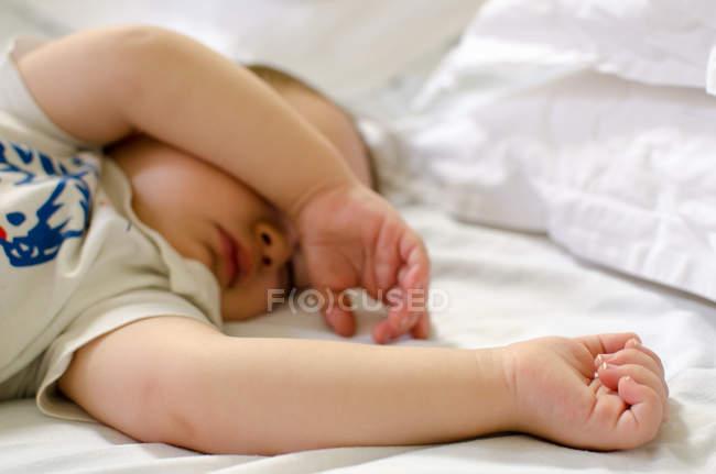 Sleeping baby on bed — Stock Photo