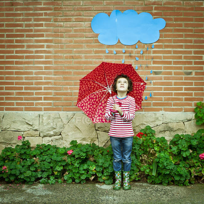 Girl with spotty red umbrella — Stock Photo