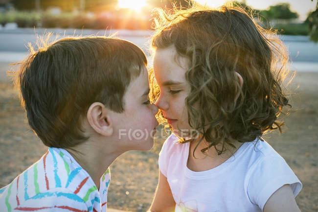 Two children standing nose to nose — Stock Photo