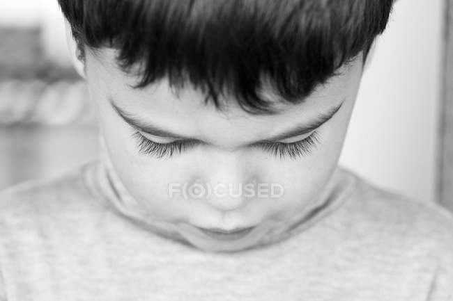 Boy looking down — Stock Photo