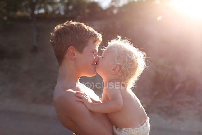 Brothers kissing each other — Stock Photo