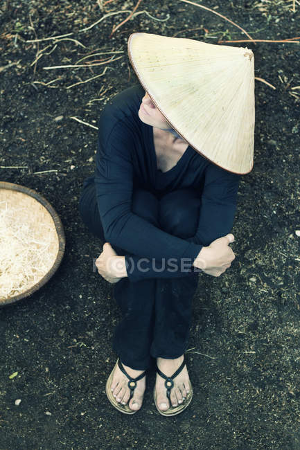 Woman wearing asian style conical hat — Stock Photo