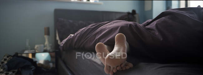 Woman lying in bed — Stock Photo