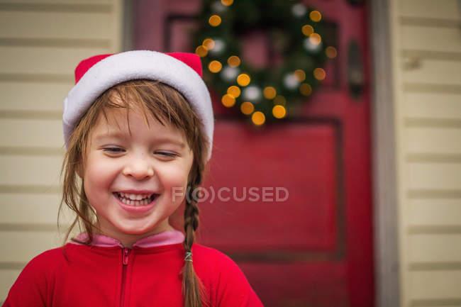 Happy girl in Christmas hat — Stock Photo