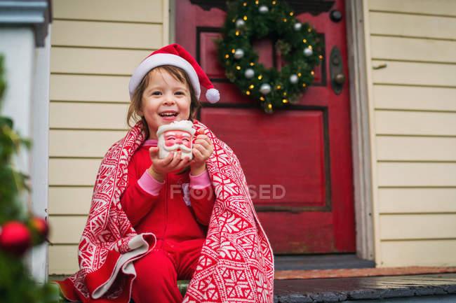 Girl drinking hot cocoa — Stock Photo