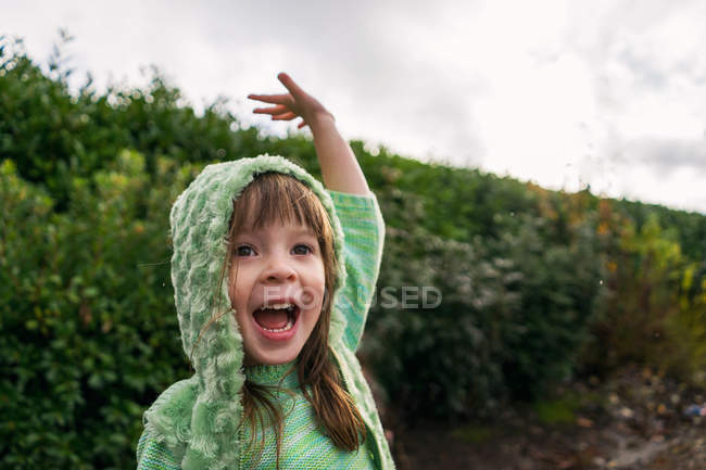 Girl yelling and waving a hand — Stock Photo