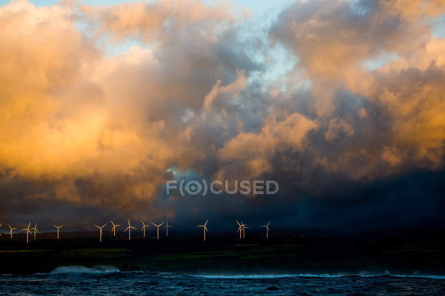 Row of wind turbines on a hill — Stock Photo