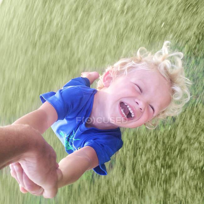 Father spinning boy around — Stock Photo