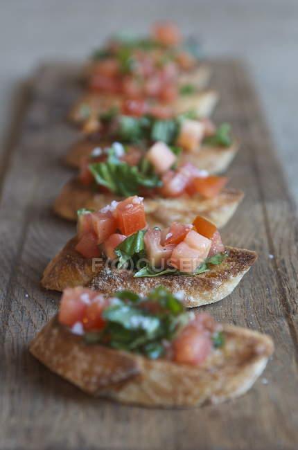 Bruschetta with tomato and basil — Stock Photo