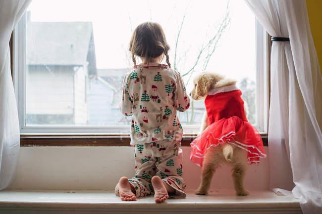Girl in pyjama with dog — Stock Photo