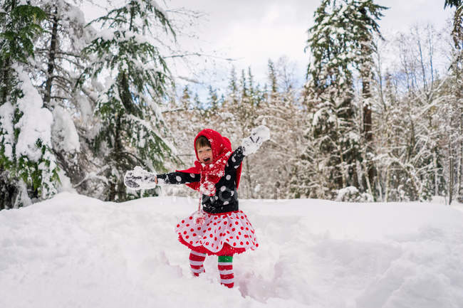 Girl messing around in snow — Stock Photo