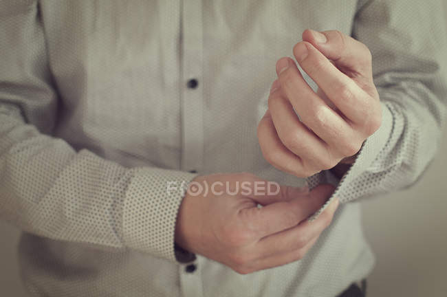 Man wearing a shirt and cufflinks — Stock Photo