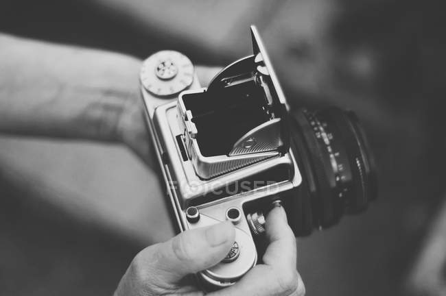 Woman holding old vintage camera — Stock Photo