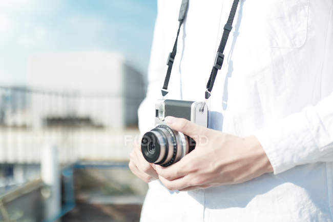 Person with vintage camera — Stock Photo