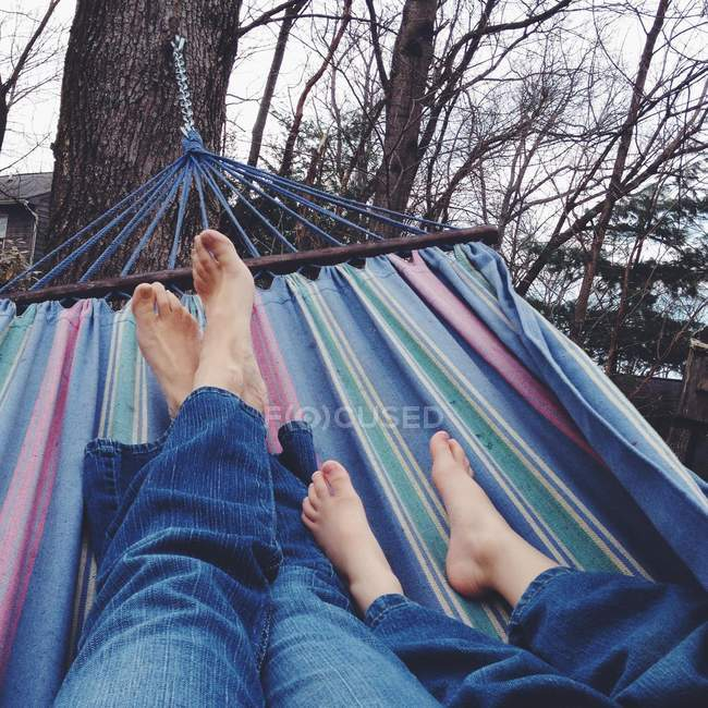 Woman and girl relaxing on hammock — Stock Photo