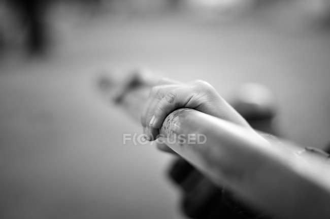 Hands of child holding railing — Stock Photo
