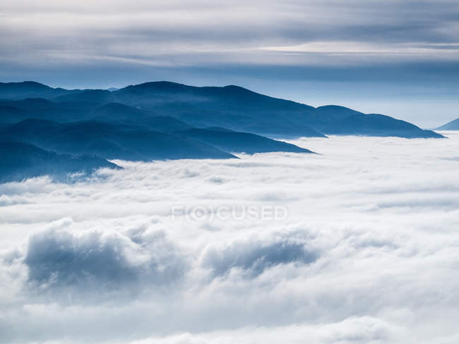 Mountains in clouds, beautiful landscape — Stock Photo