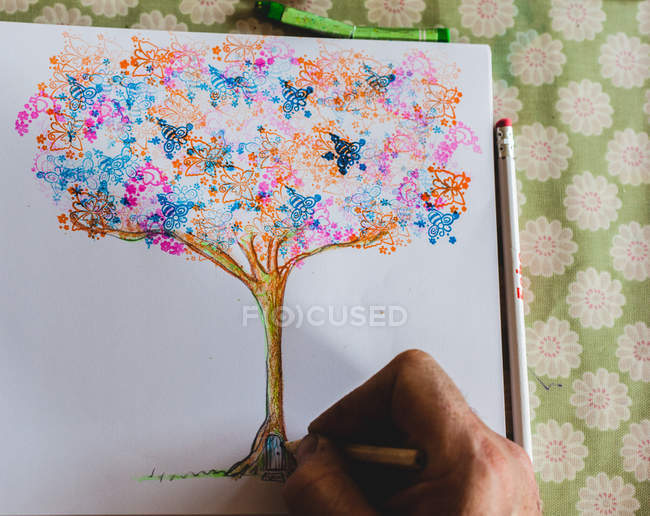 Man drawing a magical tree — Stock Photo