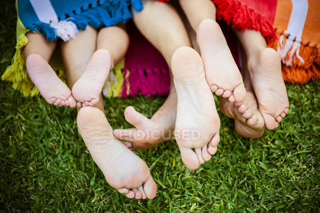 Four pairs of feet — Stock Photo