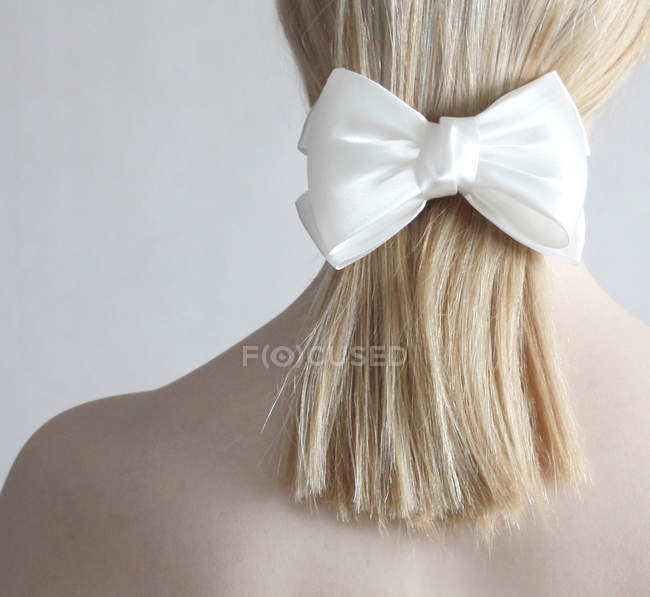 Woman wearing white bow — Stock Photo