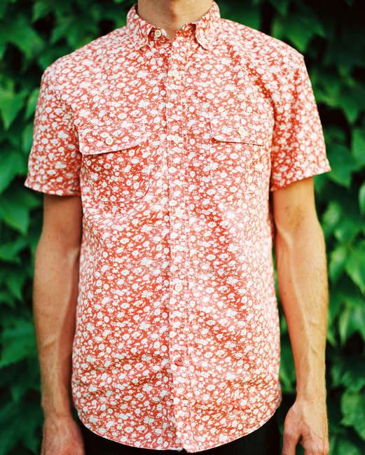 Man in orange shirt — Stock Photo