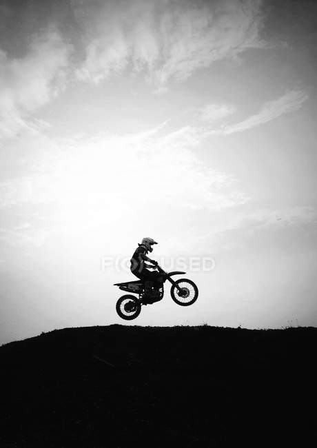Silhouette of motocross in action — Stock Photo
