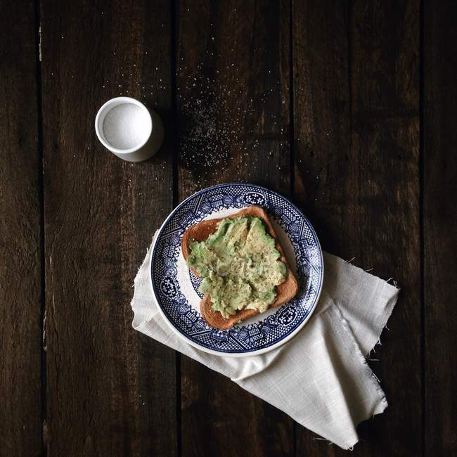 Avocado toast breakfast with salt pot — Stock Photo