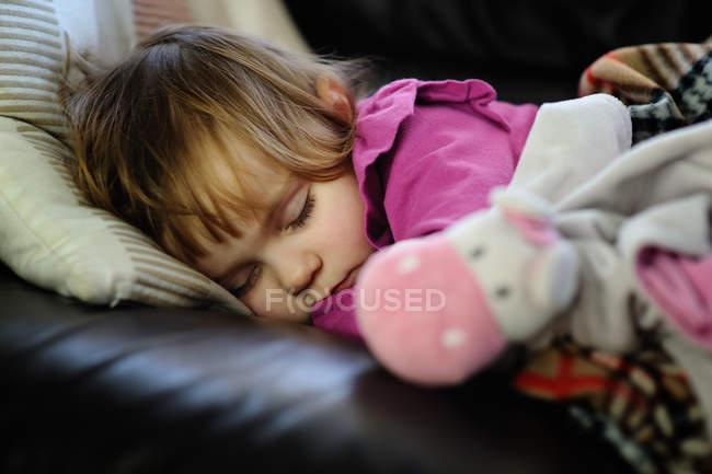 Girl sleeping on sofa — Stock Photo