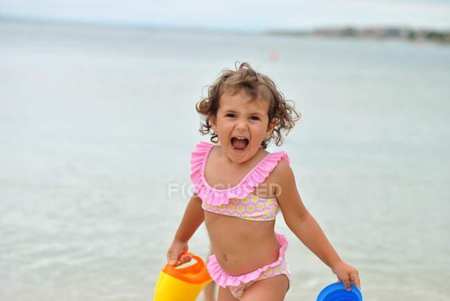 Girl in pink bikini playing — Stock Photo