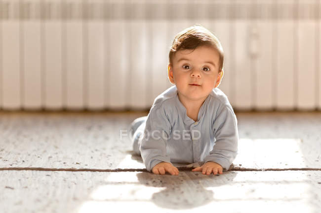 Baby boy on floor — Stock Photo