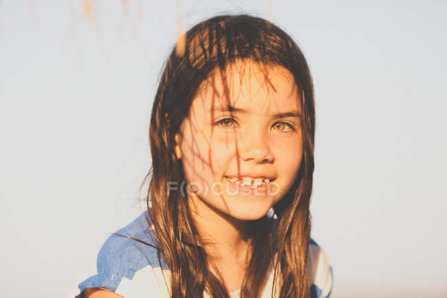 Girl with shadows on face — Stock Photo