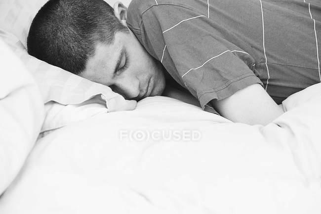 Sleeping teenage boy — Stock Photo