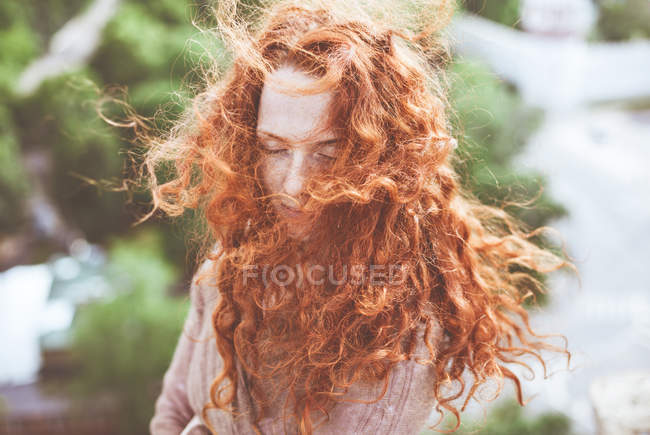 Portrait of young woman with red hair — Stock Photo