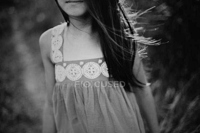 Girl with wind tousled hair — Stock Photo