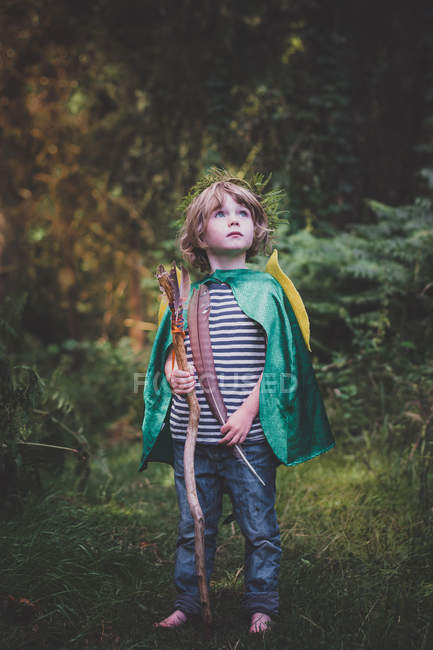 Boy with stick and feather — Stock Photo