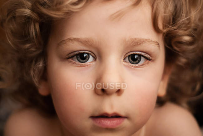Boy with curly hair — Stock Photo