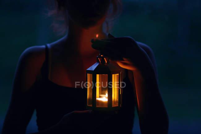Young woman holding lantern — Stock Photo