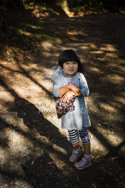 Girl holding bag with chestnuts — Stock Photo