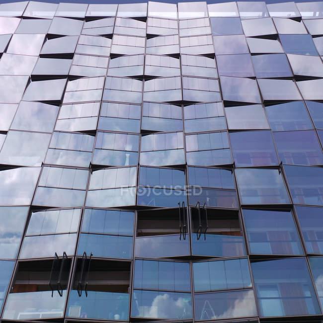 Pattern of windows on modern building — Stock Photo