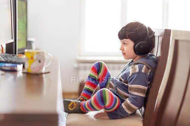 Boy watching movie on PC — Stock Photo
